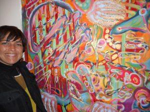 """Laura Murphy and her painting, """"Awake. Present. Healing."""""""
